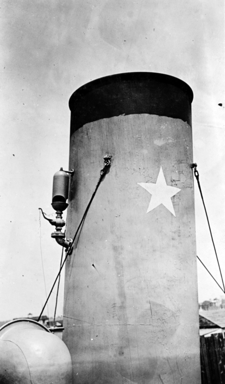 View of Christabel's smokestack, circa 1919. The star represents the German submarine she was then credited with having damaged and rendered inoperable in the Bay of Biscay on 21 May 1918. Note steam whistle on the stack. (Naval History and Heritage Command Photograph NH 55162)