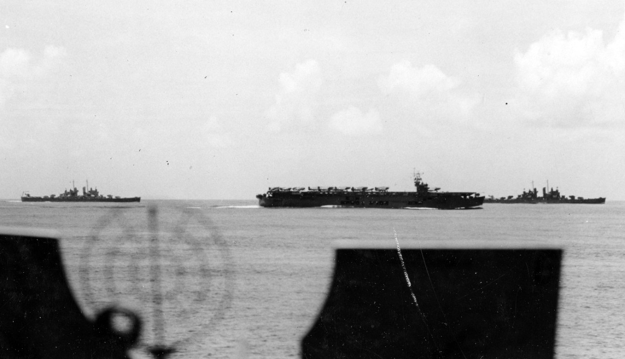 Cleveland (left), either auxiliary carrier Suwanee or Chenango (ACV-28) (middle), and light cruiser Montpelier (CL-57) (right) steaming in formation with Task Force 18, 29 January 1943. The photograph was taken from heavy cruiser Wichita (CA-45). (U.S. Navy Photograph 80-G-30223, National Archives and Records Administration, Still Pictures Branch, College Park, Md.)