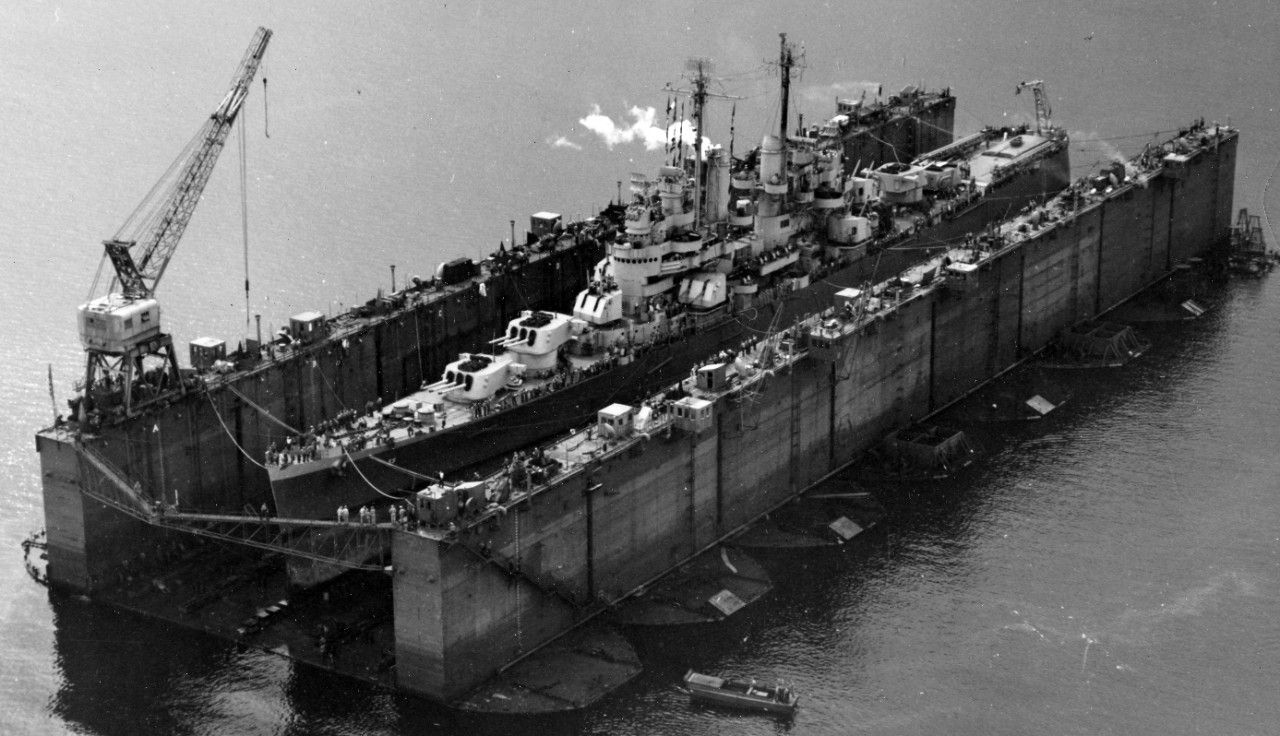 Cleveland undergoing routine overhaul in the advanced base sectional dock ABSD-1 in Espíritu Santo, New Herbides, on 13 January 1944. (U.S. Navy Photograph 80-G-224089, National Archives and Records Administration, Still Pictures Branch, College Park, Md.)