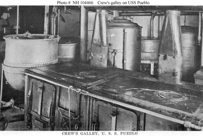 Halftone reproduction of a photograph taken in the crew's galley. Souvenir Folder. (Donation