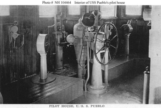 "Halftone reproduction of a photograph of the interior of the ship's pilot house, taken circa 1919. This was published in 1919 as one of ten images in a ""Souvenir Folder"" concerning Pueblo."