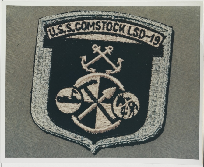 Comstock's insignia. (U.S. Navy Photograph, Naval History and Heritage Command, NH 71913-KN).