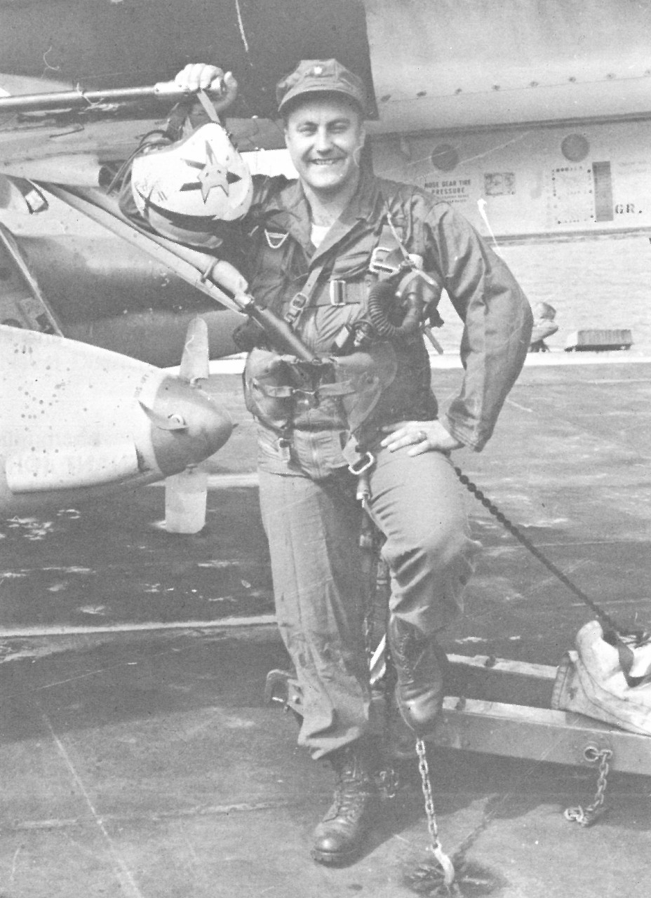 "Lt. Cmdr. Wilmer P. Cook poses with his Douglas Skyhawk A-4E, which he named the ""City of Annapolis"" in honor of his hometown.  (NHHC Archives)"