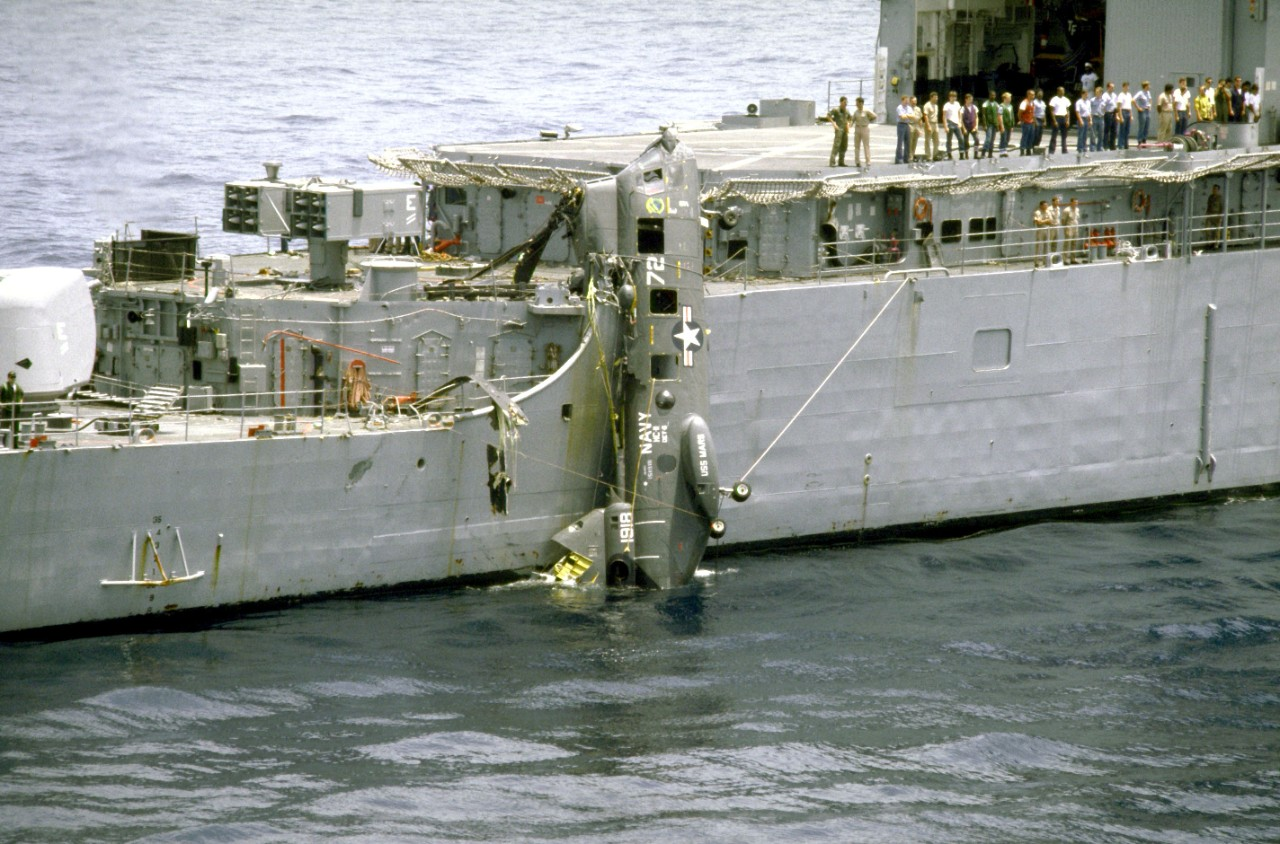 A CH-46 hangs off the side of Fife.  One of Cook's crew and some of its cryptographic equipment were on board at the time of the crash.  Fortunately, both were unharmed. (U.S. Navy Photo by PH3 Hensley, DIMOC DN-ST-87-10141)