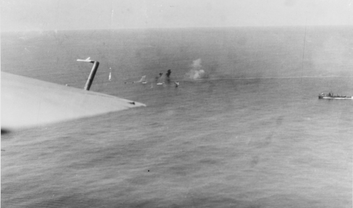 Corry (top right) advancing towards, and firing upon U-801 on 17 March 1944. (U.S. Navy Photograph 80-G-222848, National Archives and Records Administration, Still Pictures Division, College Park, Md.)