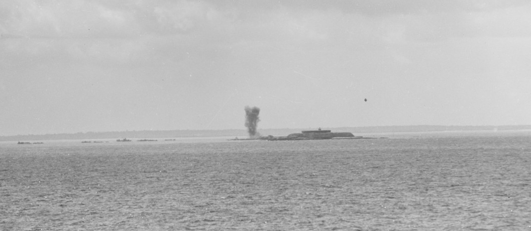 A German artillery shell explodes near the Saint Marcouf Islands, located just off of Utah Beach; taken on the morning of 6 June 1944, from Quincy (CA-71). (U.S. Navy Photograph 80-G-231643, National Archives and Records Administration, Still Pictures Division, College Park, Md.)