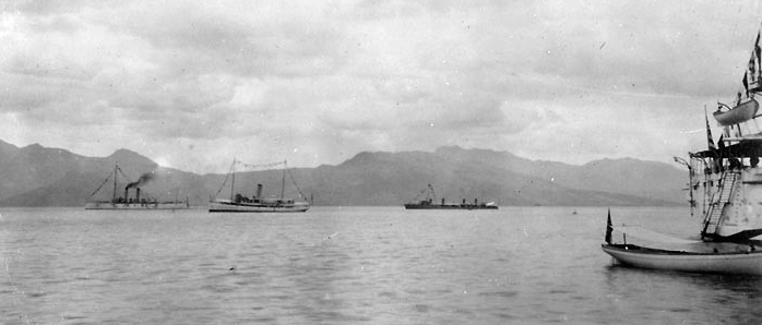 Asiatic Fleet ships dressed for George Washington's Birthday, 22 February 1915. The three ships in the distance are (from left to right): Cincinnati (Cruiser No. 7); Piscataqua (Fleet Tug No. 49); and Dale. (Naval History and Heritage Command Photograph NH 103623)