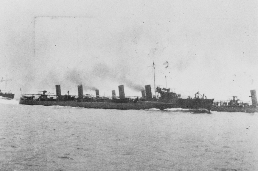 The First Torpedo Flotilla deploying into a wedge formation while steaming off Chefoo, China, during the summer of 1905. Photographed from Dale (Destroyer No. 4). The other ships present are (as numbered): 1. Decatur (Destroyer No. 5); 2. Barry (Destroyer No. 2); 3. Chauncey (Destroyer No. 3); and 4. Bainbridge (Destroyer No. 1). The Flotilla was commanded by Lt. Dudley W. Knox. Donation of Mrs. J.R. Kean, 1938. Courtesy of Capt. Dudley W. Knox, USN (Ret.). (Naval History and Heritage Command Photograph NH 52103)