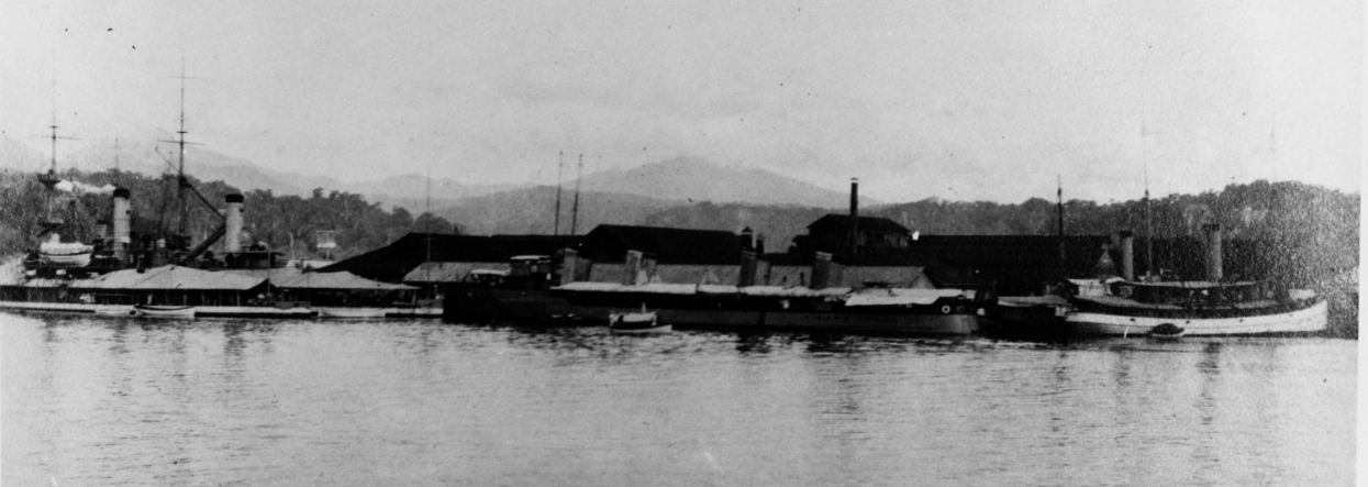 Olongapo Naval Station, Philippine Islands, view of the waterfront, circa 1914-1916. Ships present are (from left to right): Monadnock (Monitor No. 3); Monterey (Monitor No. 6); Bainbridge; Decatur; the gunboat Pampanga; and Piscataqua (Fleet Tug No. 49). Collection of C.A. Shively, 1978. (Naval History and Heritage Command Photograph NH 88559)