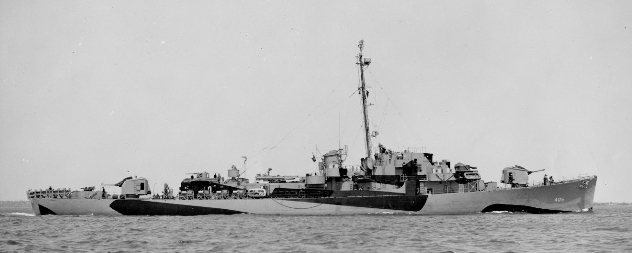 Starboard broadside view of Dennis standing out of Boston Harbor, 20 May 1944, in a two-color camouflage of Ocean Grey and Black. (U.S. Navy Bureau of Ships Photograph BS-65964-A, National Archives and Records Administration, Still Pictures Division, College Park, Md.)
