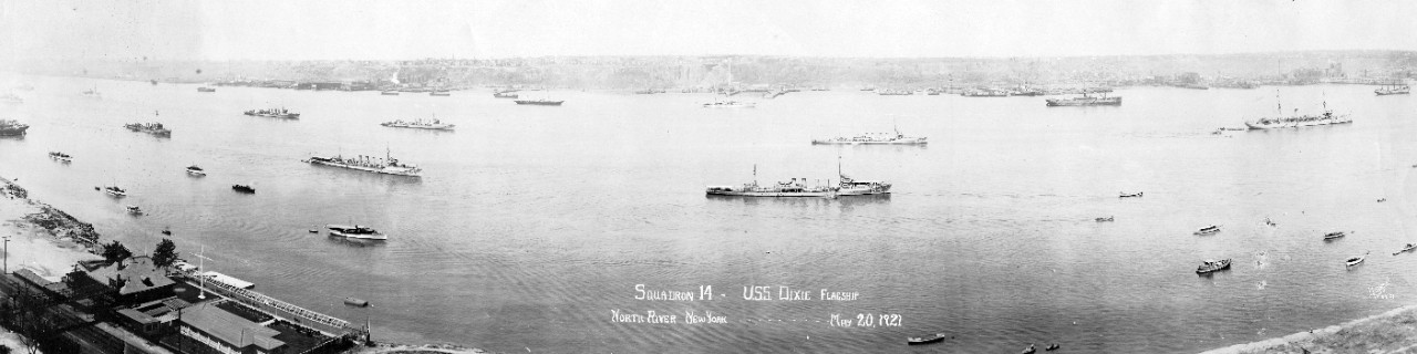 Destroyer Squadron 14 in the North River, off New York City, on 20 May 1921. Panoramic photograph by Himmel and Tyner, New York. From left to right, the ships present are Cummings (DD-44); Wainwright (DD-62); Parker (DD-48); Balch (DD-50); McDougal (DD-54); Ericsson (DD-56); and Dixie. (Naval History and Heritage Command Photograph NH 103514)