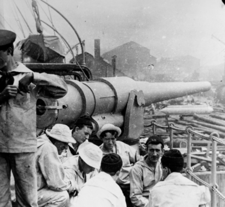 Sailors relax by the 6-inch gun on Dixie's starboard side spar deck during the Spanish-American War, 1898. (Naval History and Heritage Command Photograph NH 67456)