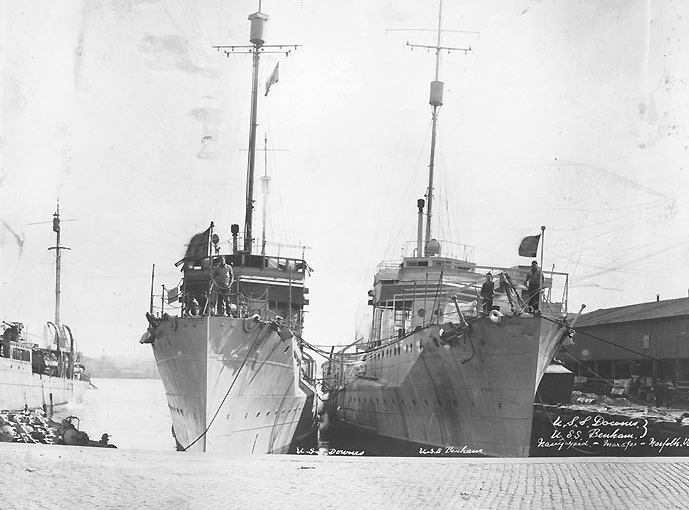 Downes, at left, and Benham (DD-49) at the Norfolk Navy Yard, Portsmouth, Va., 5 March 1921. (Photographed by Crosby, 324 First Street, Portsmouth, Va.; Naval History and Heritage Command Photograph NH 104056)