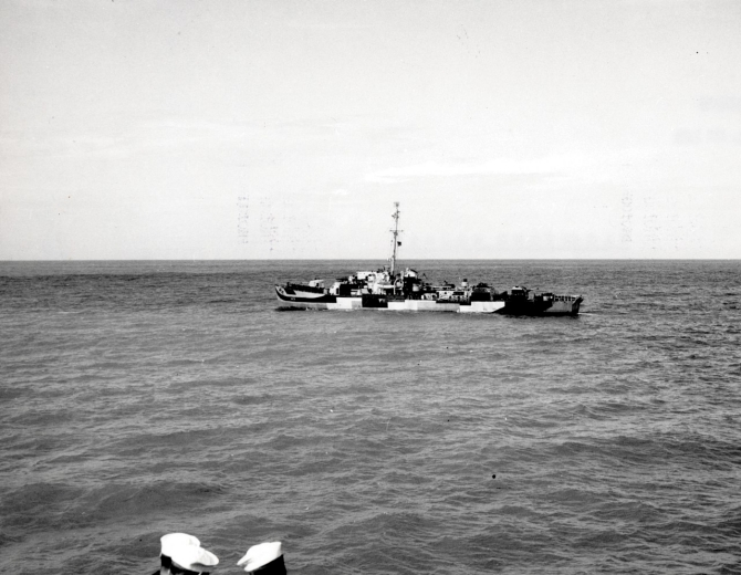 Dufilho slows to steerageway while operating with another ship (just out of the picture at the bottom), circa 1944. (U.S. Navy Photograph 298905, Dufilho (DE-423), Ships History, Naval Heritage and History Command)