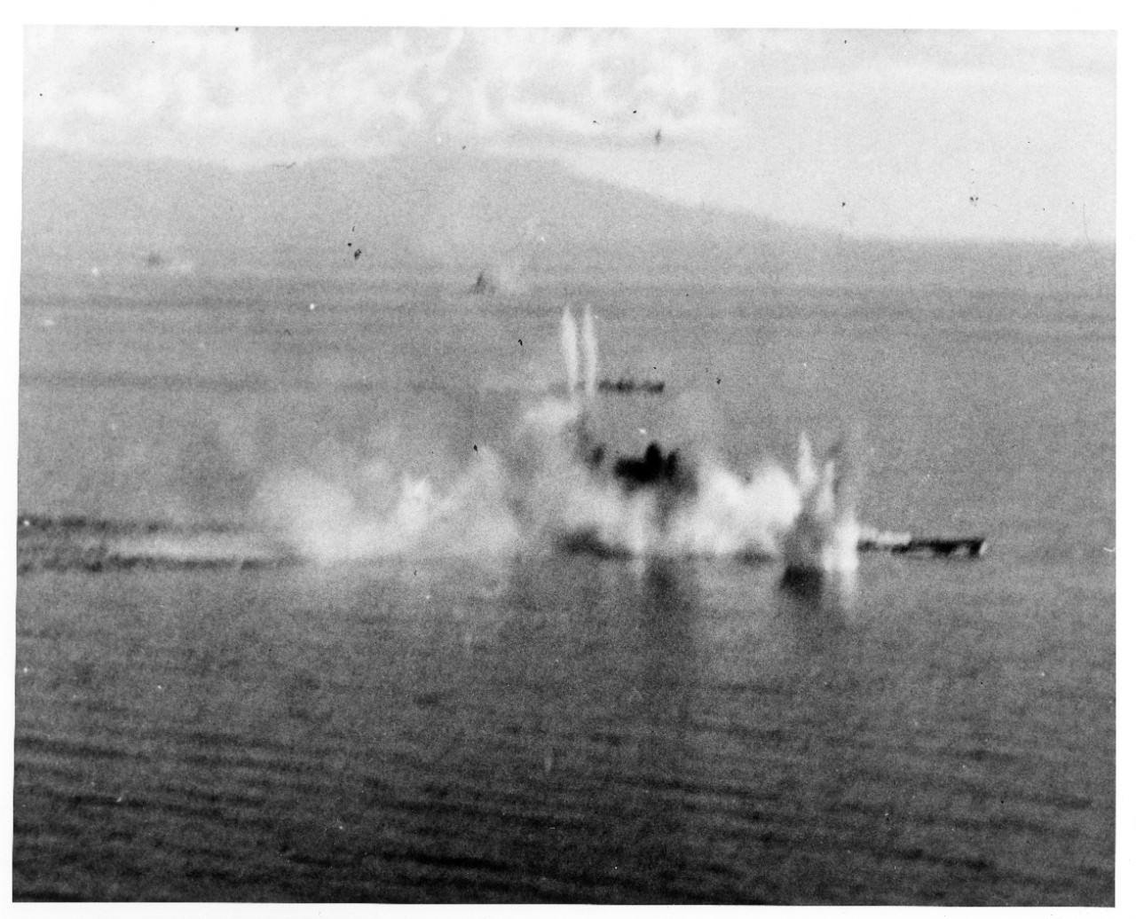 Flames and splashes from exploding bombs and torpedoes erupt around Musashi as Helldivers and Avengers tear into the battleship while she attempts to cross the Sibuyan Sea, 24 October 1944. (U.S. Navy Photograph 80-G-281764, National Archives and Records Administration, Still Pictures Branch, College Park, Md.)
