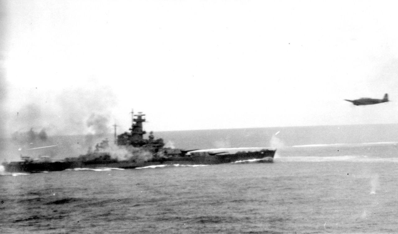A Japanese Nakajima B5N2 Type 97 carrier attack plane hurtles past South Dakota during the Battle of the Santa Cruz Islands, 26 October 1942. The aircraft -- probably one of Imajuku's Nakajima B5N2 Type 97 carrier attack planes -- has apparently just dropped its torpedo and flies through a hail of fire erupting from the battleship. (National Archives Photograph 80-G-30054, Still Pictures Branch, National Archives & Records Administration, College Park, Md.)