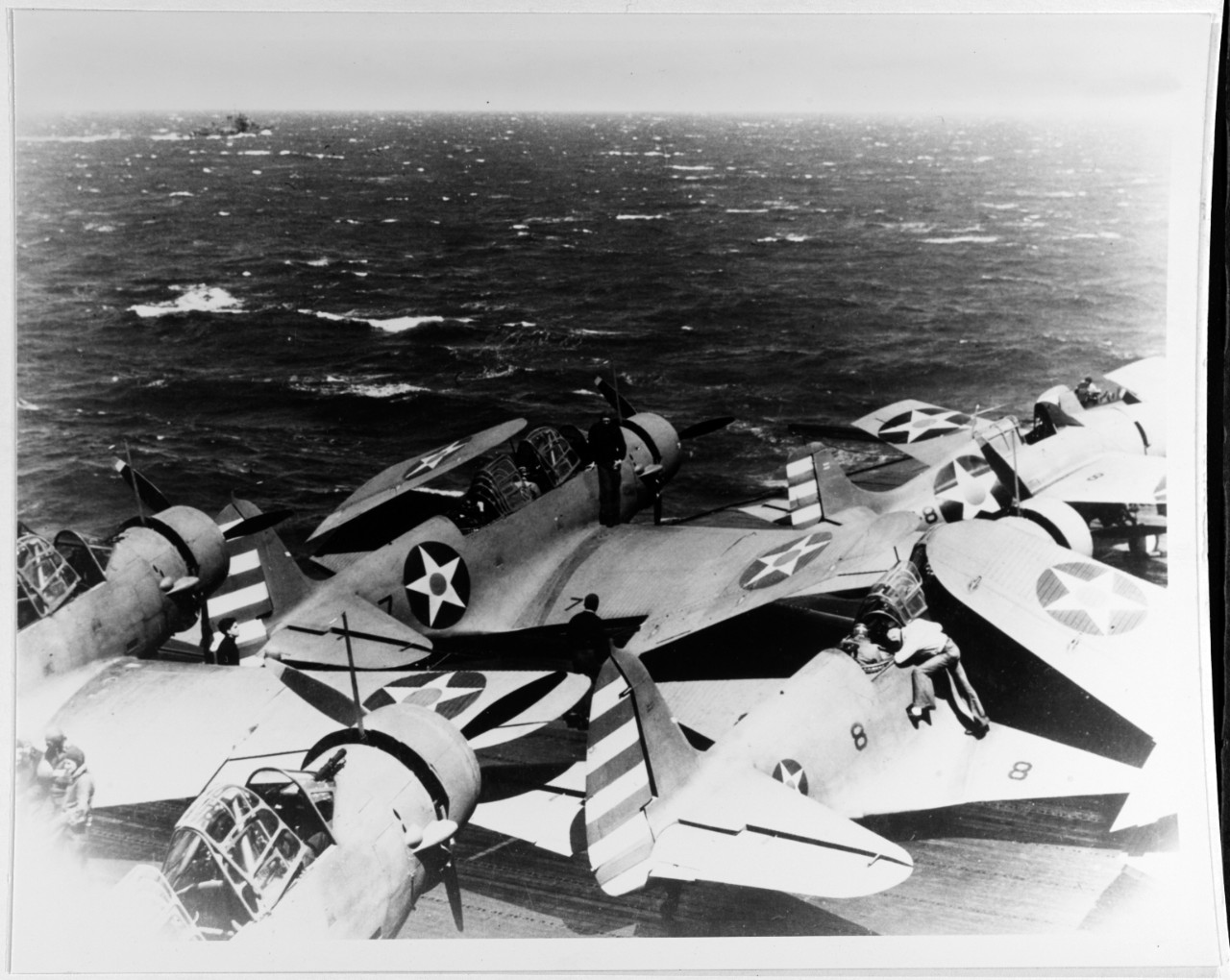 Wildcats and Devastators pack the flight deck of Enterprise as she steams toward Japanese waters during the Halsey-Doolittle Raid, 11 April 1942. (Naval History and Heritage Command Photograph NH 85536)