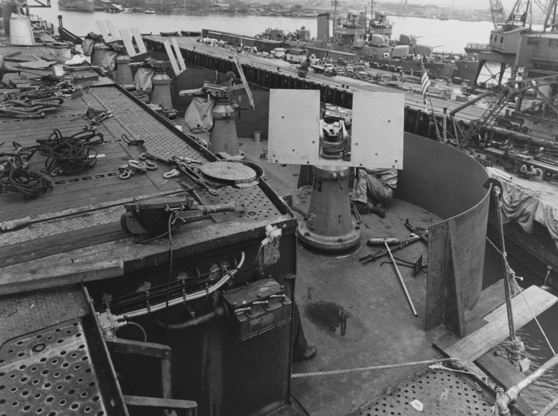 This view shows some of the 20 millimeter guns being installed at Pearl Harbor Navy Yard, 19 March 1942. Fanning (DD-385) and Gridley (DD-380) are moored nearby (right background). (Naval History and Heritage Command Photograph NH 81081)