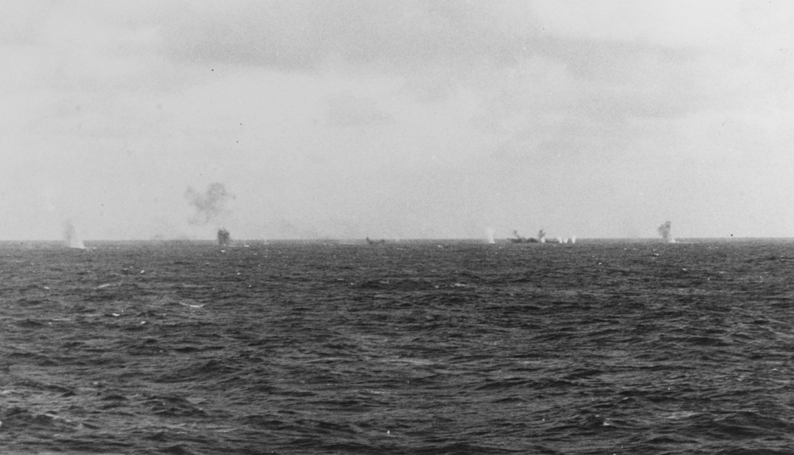 Balch, Maury, and planes from Enterprise sink one of the Japanese guardboats (right — black smudge) off Wake, 24 February 1942. A man on board Salt Lake City snaps the shot. (Naval History and Heritage Command Photograph NH 50949)