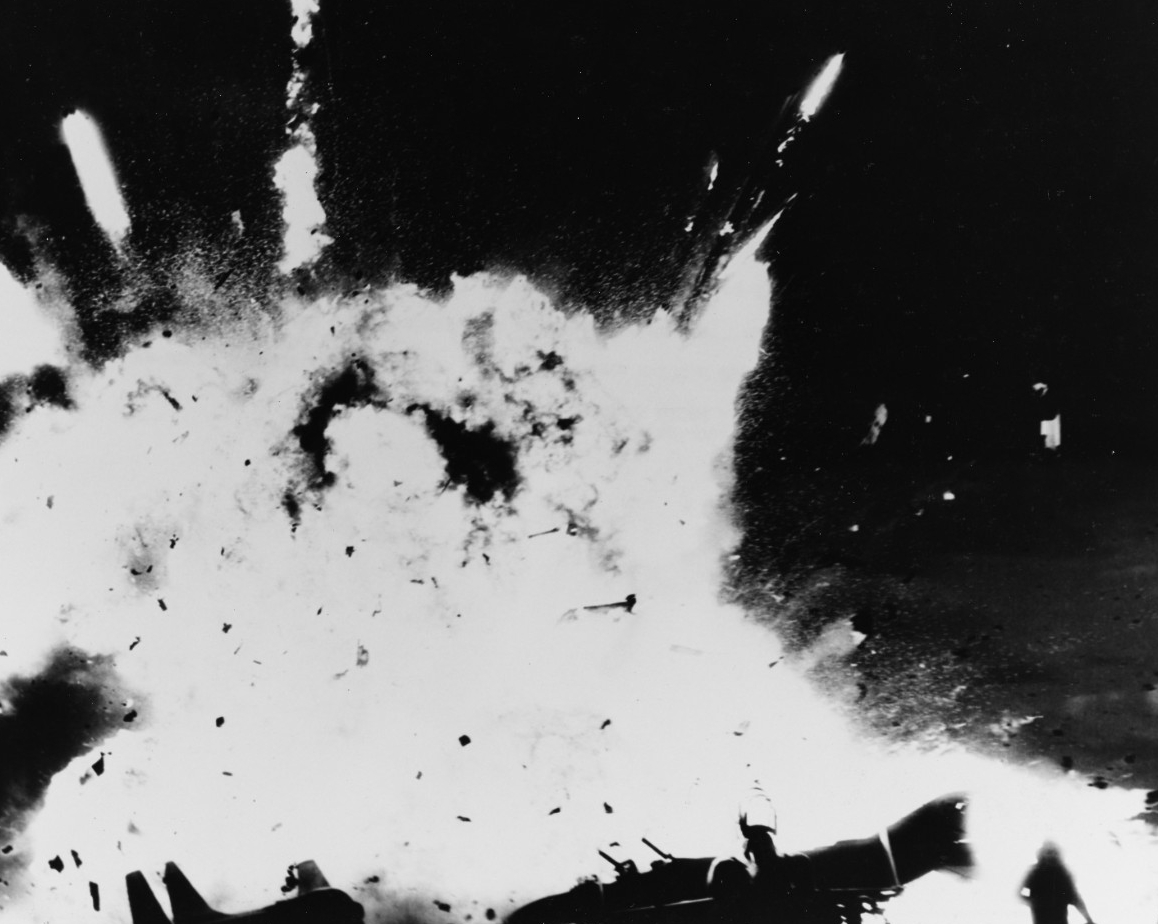 Aircraft and ordnance explode on the ship's flight deck, 14 January 1969. (U.S. Navy Photograph 1137377, National Archives and Records Administration, Still Pictures Division, College Park, Md.)