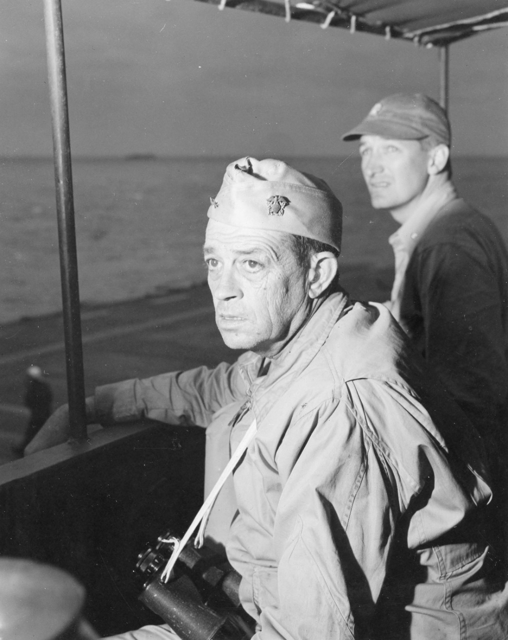 The tension of the Okinawa campaign clearly shows on the faces of Rear Adm. Sprague and Lt. Cmdr. Anderson F. Hewitt as they watch flight operations from the bridge, April 1945. (U.S. Navy Photograph 80-G-371327, National Archives and Records Administration, Still Pictures Division, College Park, Md.)