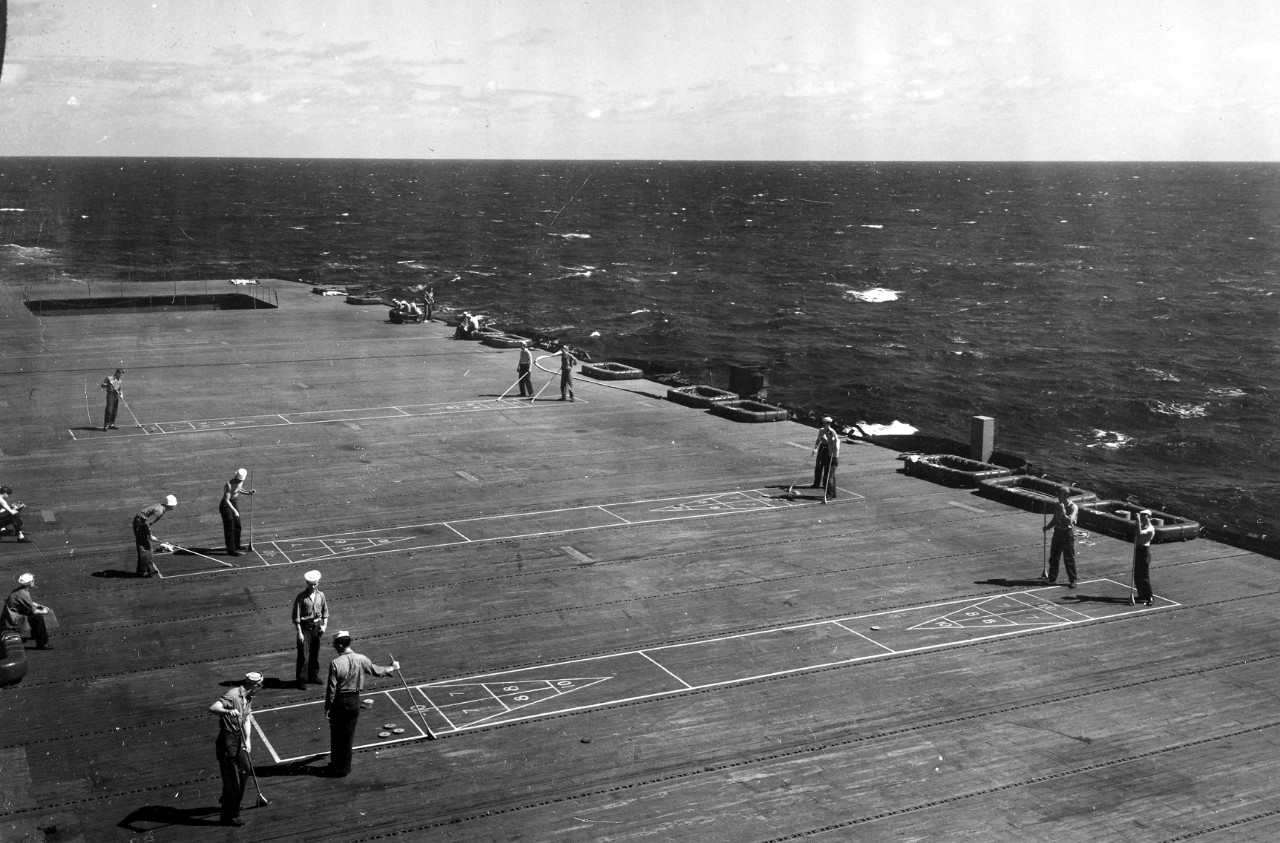 Cruise ship or carrier? Sailors play shuffleboard on Fanshaw Bay's flight deck, 25 October 1945. (U.S. Navy Photograph 80-G-364261, National Archives and Records Administration, Still Pictures Division, College Park, Md.)