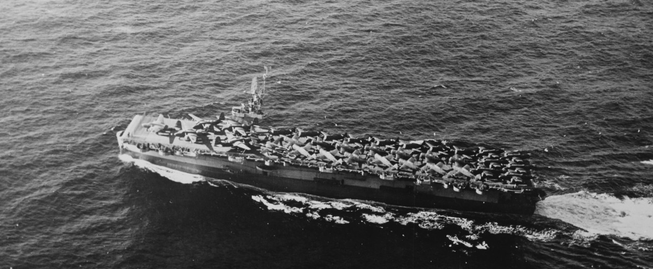 An overhead view of Fanshaw Bay during the shakedown cruise shows her cleanly knifing through the waves, her flight deck packed with USAAF P-47 Thunderbolts, P-38 Lightnings, and A-20 Havocs, January–February 1944. (U.S. Navy Photograph 80-G-214080, National Archives and Records Administration, Still Pictures Division, College Park, Md.)