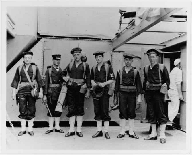Signalmen of Florida's Landing Force, before going ashore at Veracruz, Mexico, in April 1914. These men are identified as: Windrell, Repp, C.M.M., Green and Bishop (only five listed). Note their military pistol belts with suspenders, canteens and other field gear. Several men are wearing their flat hats beret-style, without grommets. Photograph and caption were provided by Chaplain C.H. Dickins, USN, 1926. (U.S. Naval History and Heritage Command Photograph NH 63286)