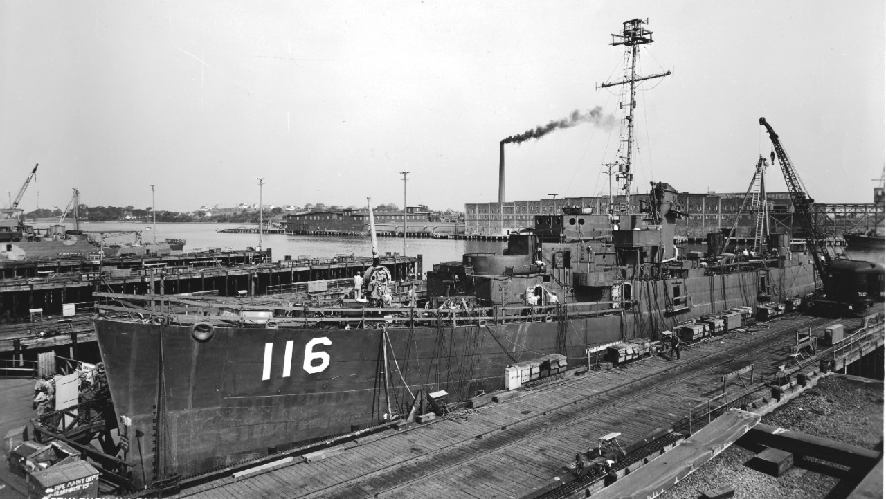 At the outfitting dock at the Bethlehem-Hingham yard, 5 July 1945, one month after launching. Note 5-inch/38 Mount 51 at high elevation, the gunhouse not yet being fitted, and a sister ship in the upper left background in what appears to be three-color camouflage. (U.S. Navy Bureau of Ships Photograph BS 85929, 19-LCM Box 145, National Archives and Records Administration, Still Pictures Division, College Park, Md.)