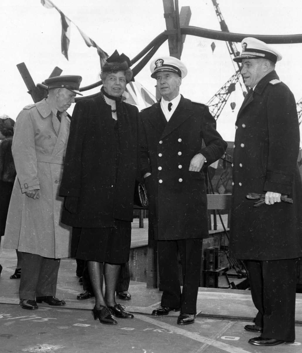 (Left–right) Gen. of the Army George C. Marshall Jr., USA, Army Chief of Staff, First Lady Eleanor Roosevelt, Flt. Adm. Ernest J. King, Chief of Naval Operations (CNO), and Commander in Chief United States Fleet, and Rear Adm. Freeland A. Daubin, Commander New York Navy Yard, observe Coral Sea (CVB-42) as she is launched, 29 April 1945. (Naval History and Heritage Command Photograph L38-76.02.03)