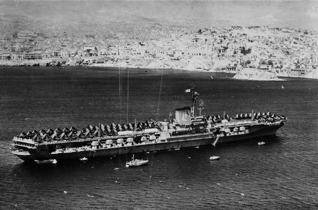 Franklin D. Roosevelt anchors in the bay off Piraeus in her important task of emphasizing U.S. resolve for the Greek government against the communists, 5–9 September 1947. (Naval History and Heritage Command Photograph 2014.10.01)