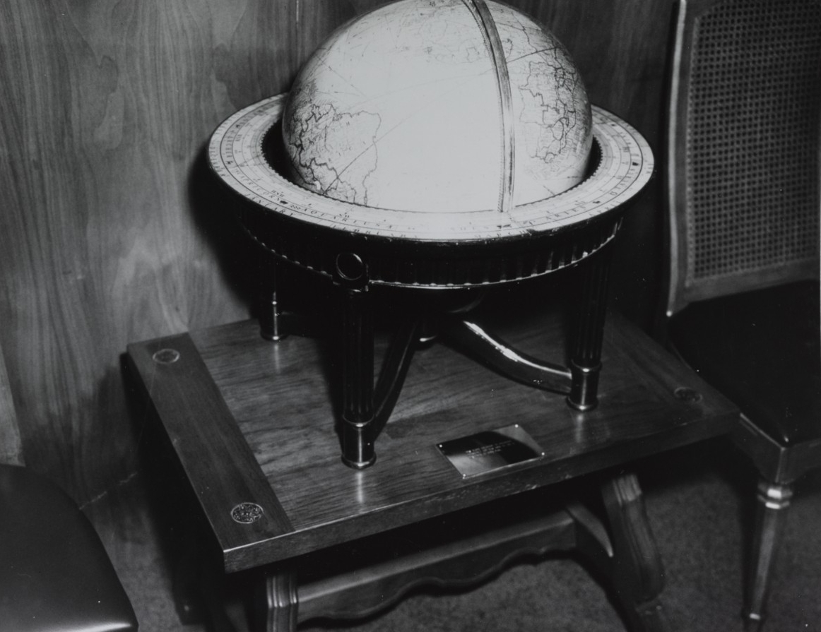 The ship receives the donation of this unique globe of the earth, which once belonged to her namesake President Franklin D. Roosevelt, in 1969. (Naval History and Heritage Command Photograph NH 68719-KN)