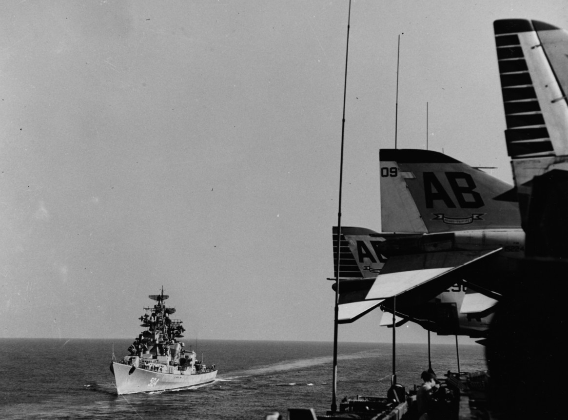 The Soviets keep close tabs on the carrier and one of their Kashin class destroyers closes her in the Mediterranean, 25 September 1967. The Soviets repeatedly shift their identifying pennant numbers but here the vessel displays 504 as she brazenly passes close aboard. (Naval History and Heritage Command Photograph 1126696)