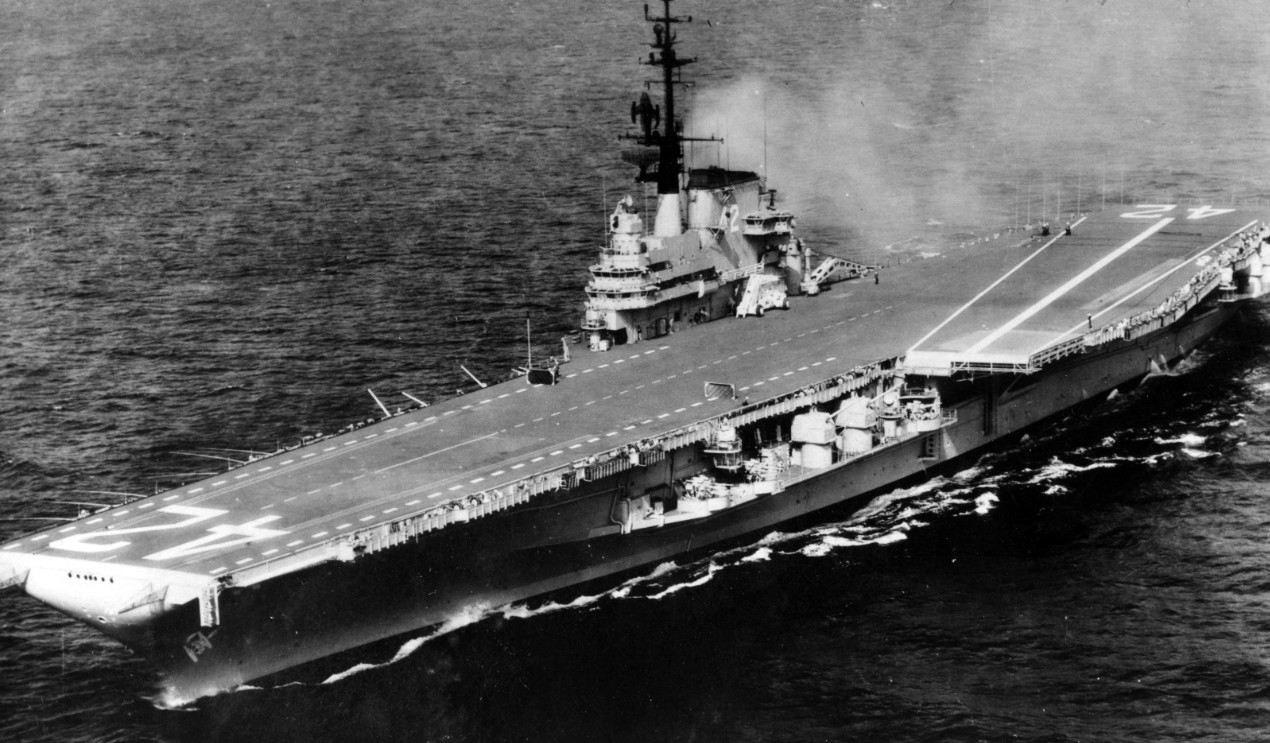 The ship emerges from the yard work with an entirely new silhouette, and her angled flight deck is clearly visible in this port bow image taken sometime after her recommissioning, 6 April 1956. (Naval History and Heritage Command Photograph UA 543.03)