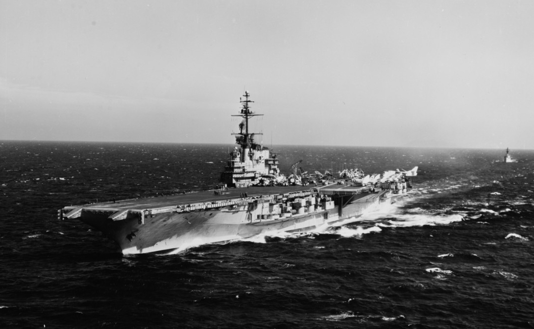 A mix of aircraft are parked on Franklin D. Roosevelt's flight deck as she steams at sea, a plane guard escort faithfully following in her wake, 3 March 1963. (Naval History and Heritage Command Photograph 1074673)