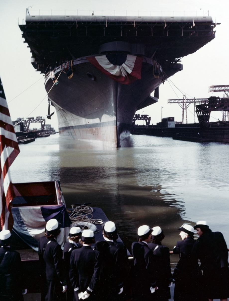 Franklin is floated out of her building dock following her christening at the Newport News Shipbuilding & Dry Dock Company shipyard, Newport News, on 14 October 1943. Note the WAVES officers in the foreground. (U.S. Navy Photograph 80-G-K-14015, National Archives and Records Administration, Still Pictures Division, College Park, Md.)
