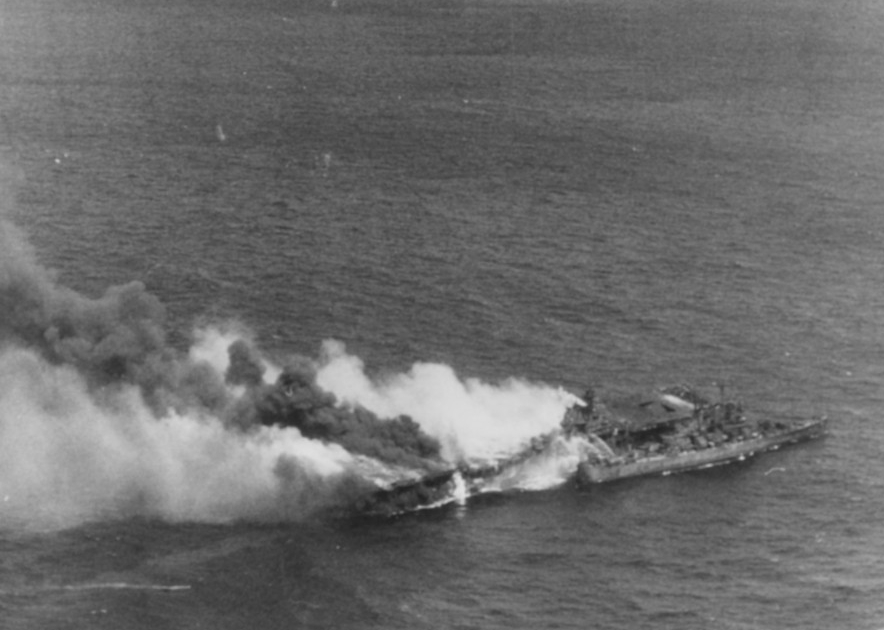 Franklin, dead in the water and burning furiously following the air attack on 19 March 1945. Note, Santa Fe (CL-60) alongside her assisting in the evacuation. (U.S. Navy Photograph 80-G-373734, National Archives and Records Administration, Still Pictures Division, College Park, Md.)
