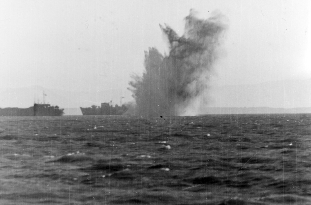 A Luftwaffe aircraft's bomb explodes amongst the invasion shipping off Anzio, on 22 January 1944. The vessel in the background is possibly HMS Princess Beatrix. Photographed from on board Frederick C. Davis (U.S. Navy Photograph 80-G-223444, National Archives and Records Administration, Still Pictures Division, College Park, Md.)