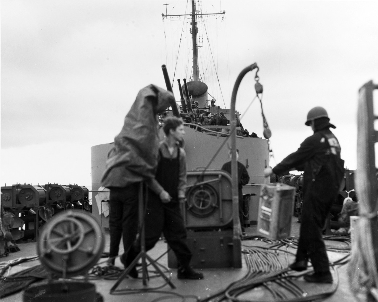 Crewmembers of Frederick C. Davis at work on the ship's fantail, during Operation Shingle. (U.S. Navy Photograph 80-G-223466, National Archives and Records Administration, Still Pictures Division, College Park, Md.)