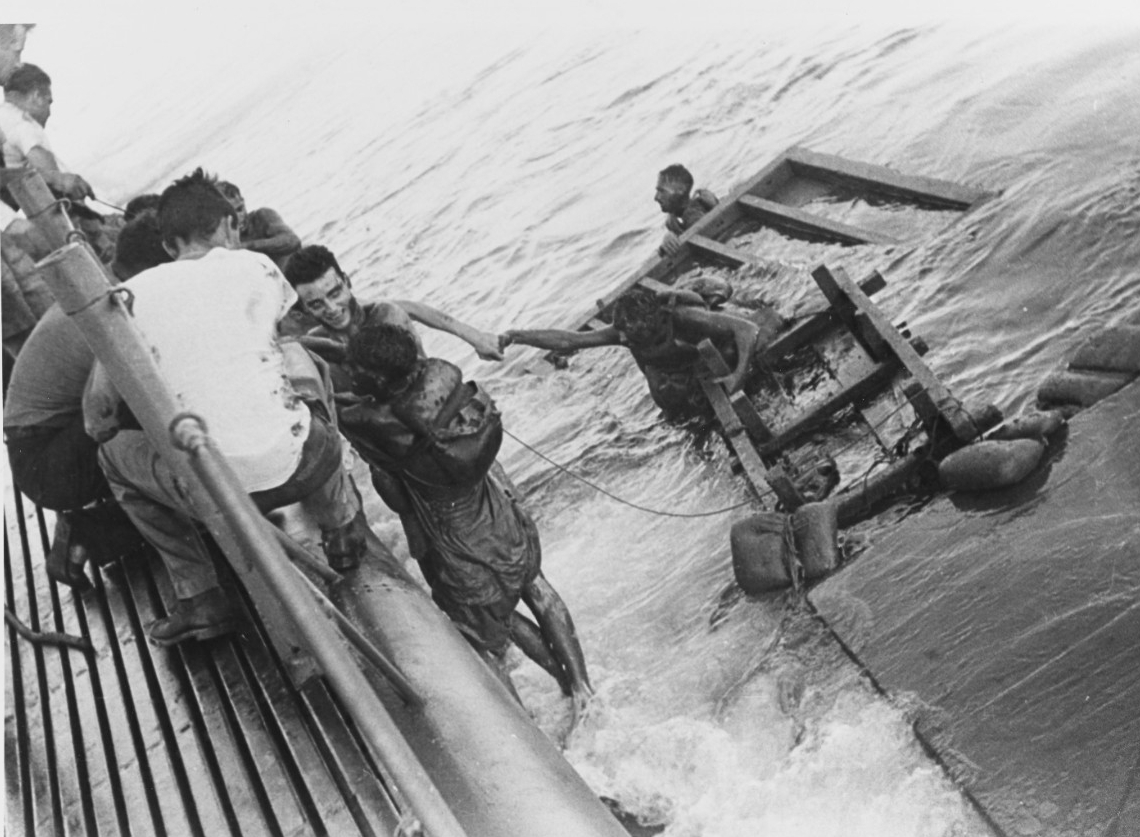 Emaciated British and Australian prisoners of war being rescued by Sealion (SS-315) on 15 September 1944. The POWs had been on board unmarked transports en route from Singapore to Japan when their ships were sunk by Sealion, Growler, and Pampanito (SS-383) on 12 September 1944. (U.S. Navy Photograph 80-G-281718, National Archives and Records Administration, Still Pictures Division, College Park, Md.)