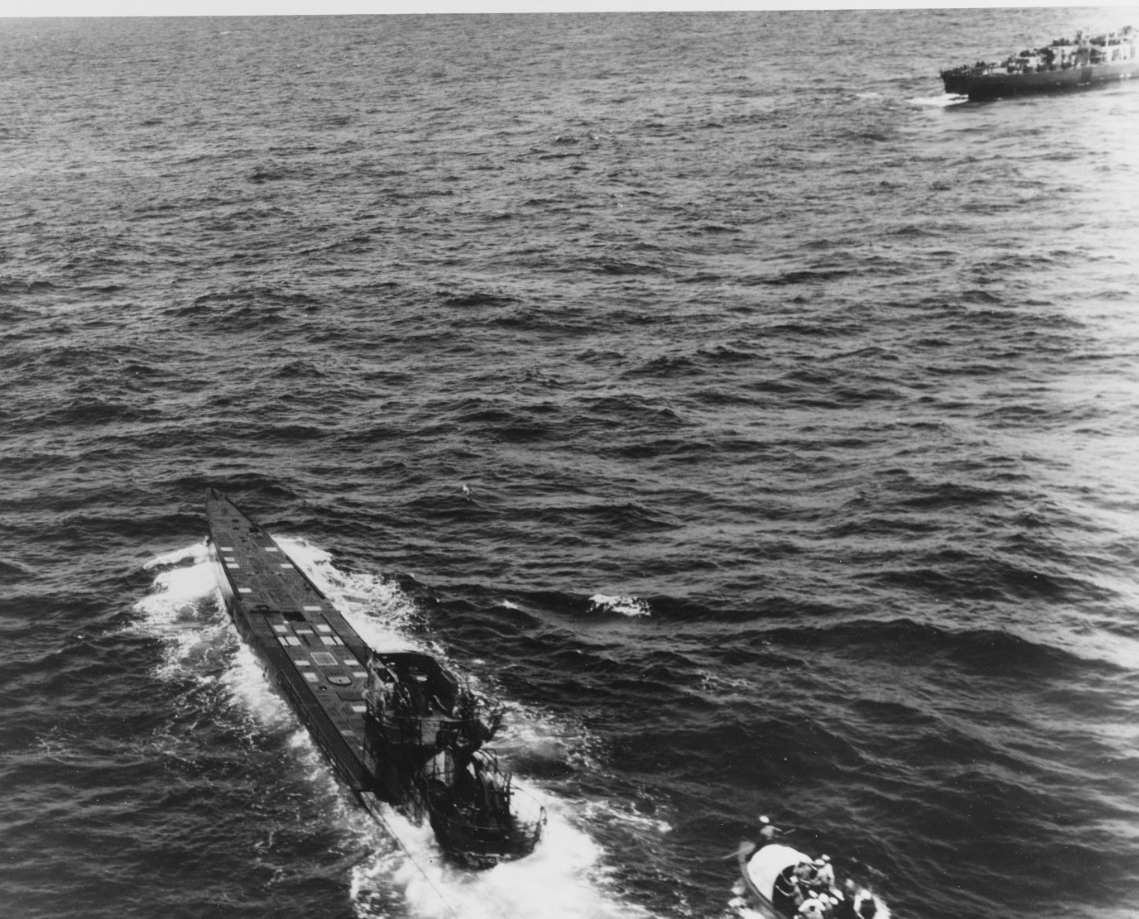 Lt. (j.g.) David leads his boat crew (lower right) toward U-505, which continues to steam though abandoned by her crew, 4 June 1944. Chief Jacobson stands ready with a boarding gaff in the boat's bow. (U.S. Navy Photograph 80-G-49166, National Archives and Records Administration, Still Pictures Division, College Park, Md.)