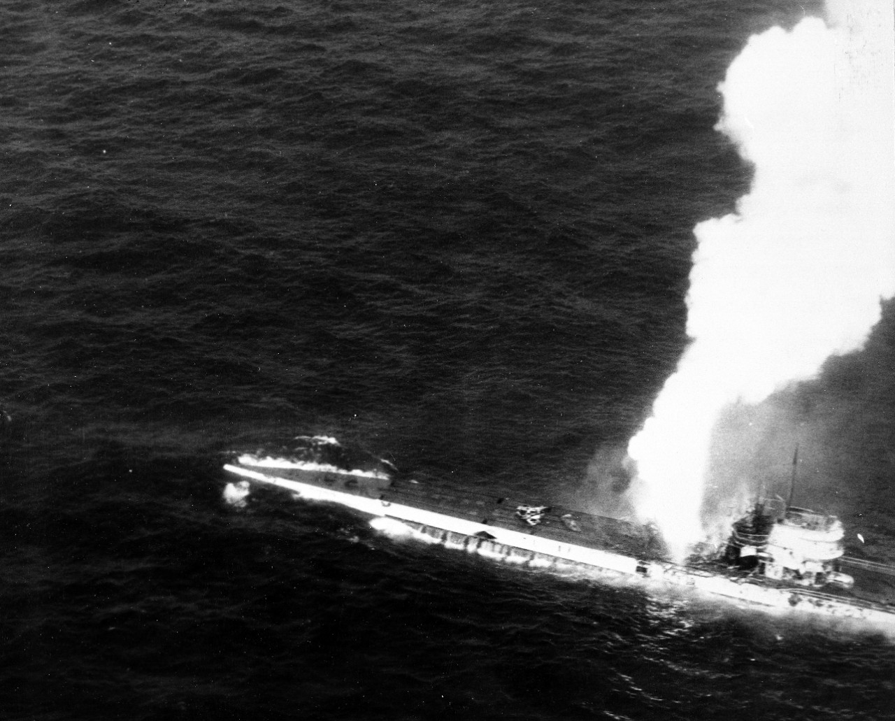 A plane flying from Guadalcanal snaps a picture of U-515 as the submarine burns and sinks, 9 April 1944. The explosion appears to be erupting from the boat's aft antiaircraft gun battery. (U.S. Navy Photograph 80-G-227197, National Archives and Records Administration, Still Pictures Division, College Park, Md.)
