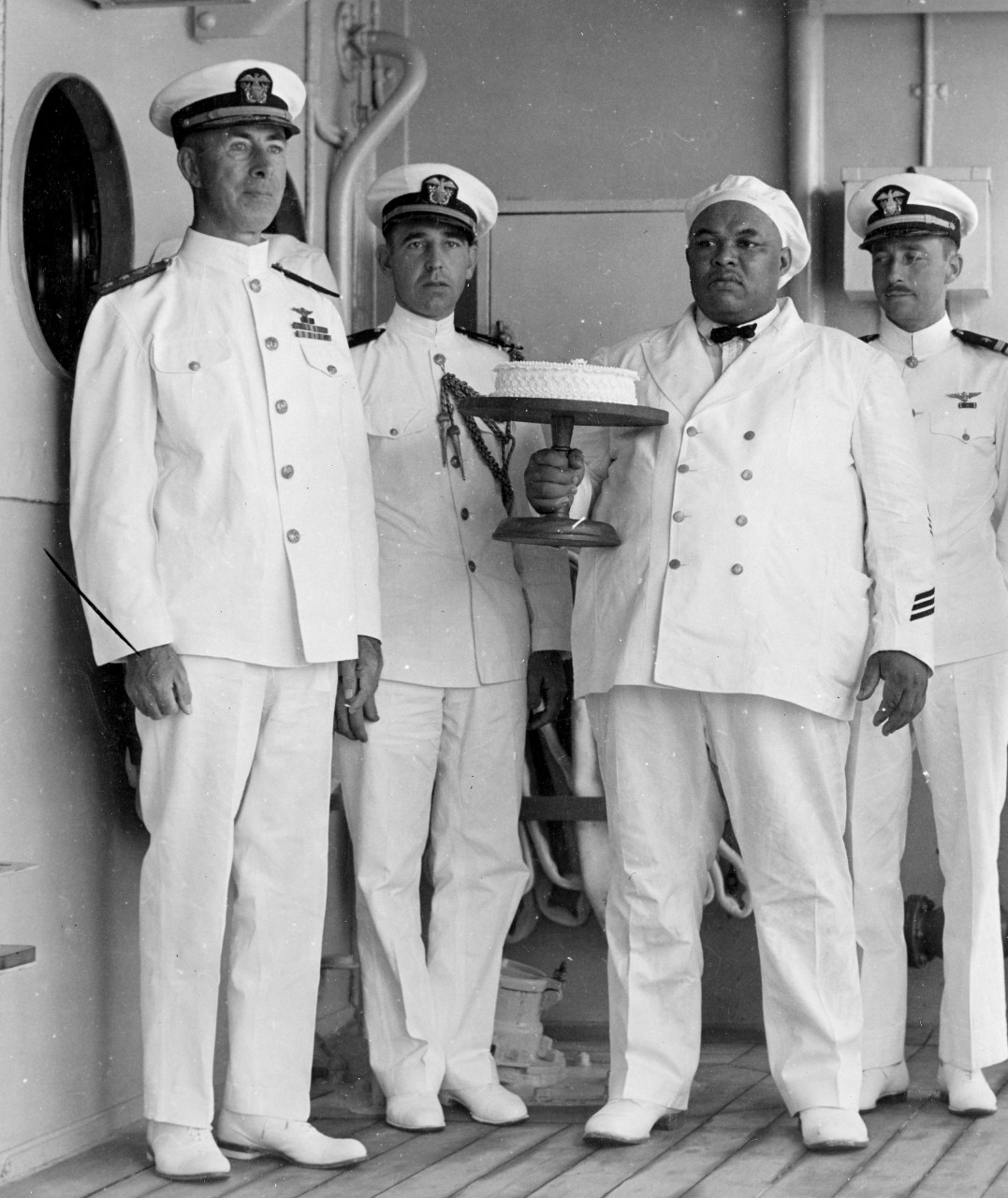 Rear Adm. Halligan and Lt. Ward receive cake, 18 May 1934. (U.S. Navy Photograph 80-G-462748, National Archives and Records Administration, Still Pictures Division, College Park, Md.)