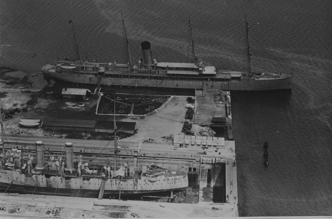 Hancock at Pearl Harbor Navy Yard, 23 July 1924. Notice the ship undergoing maintenance in dry dock in the foreground. (U.S. Navy Photograph 80-G-1017213, National Archives and Records Administration, Still Pictures Division, College Park, Md.)
