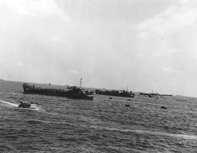 APA-106-3: Tank landing ships (LSTs) offshore during the fierce fighting for Iwo Jima, 19 February 1945.