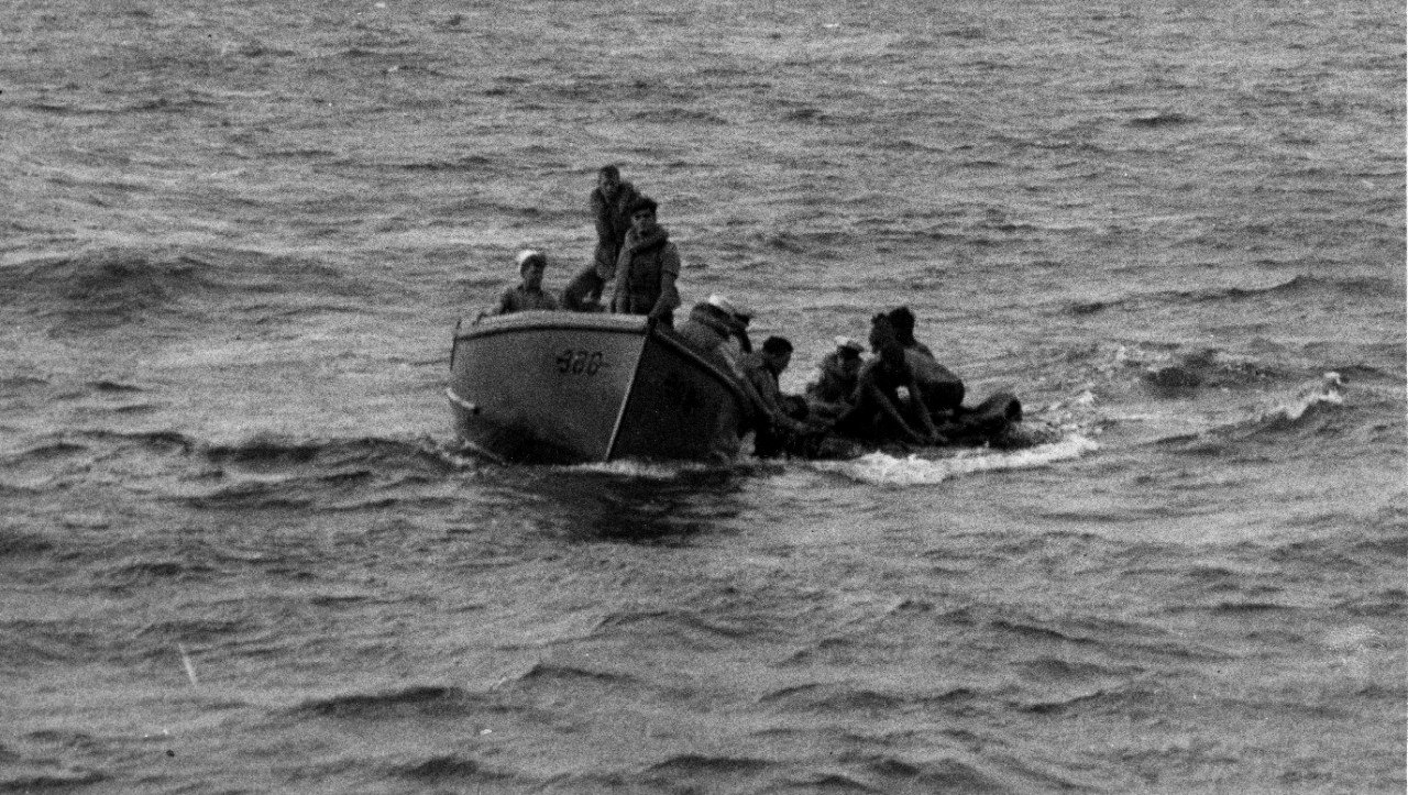Helm's 26-foot motor whaleboat crew rescues Neosho survivors, one of whom would die before the day was out. (U.S. Navy Photograph 80-G-32132, National Archives and Records Administration, Still Pictures Division, College Park, Md.)
