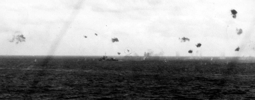 A kamikaze sets his sights on Helm, 5 January 1945, as seen from Wake Island (CVE-65). (U.S. Navy Photograph 80-G-273082, National Archives and Records Administration, Still Pictures Division, College Park, Md.)