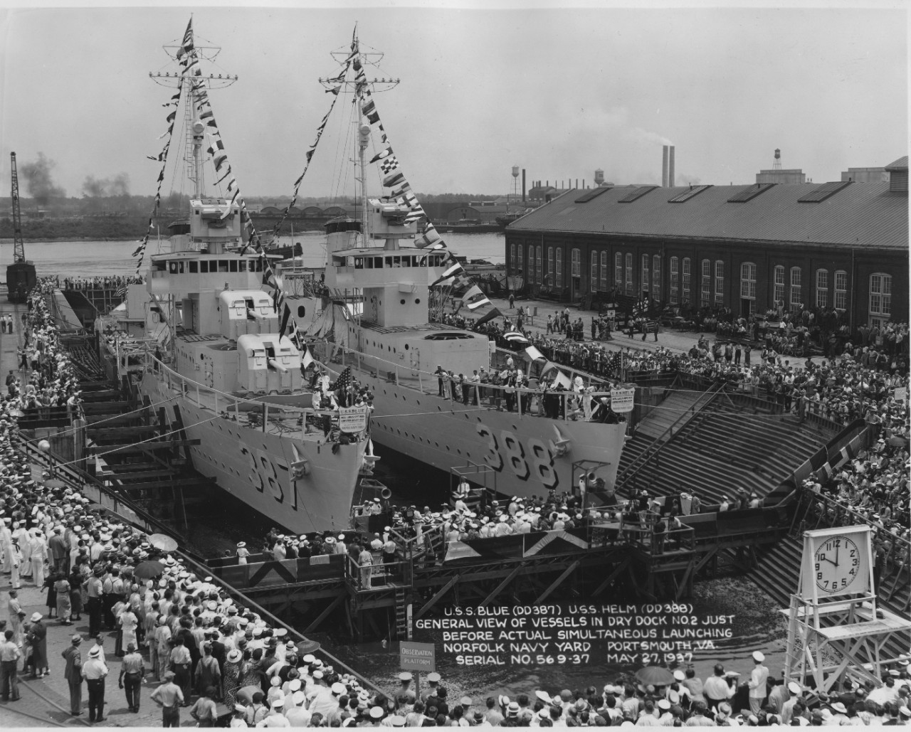 Blue (DD-387) (L) and Helm await christening in the partially flooded Dry Dock No. 2 at the Norfolk Navy Yard, 27 May 1937. Blue appears to have her guns and torpedo tubes installed, and both ships' Mk. 33 main battery gun directors are in place. (U.S. Navy Bureau of Ships Photograph 19-N-18066, National Archives and Records Administration, Still Pictures Division, College Park, Md.)