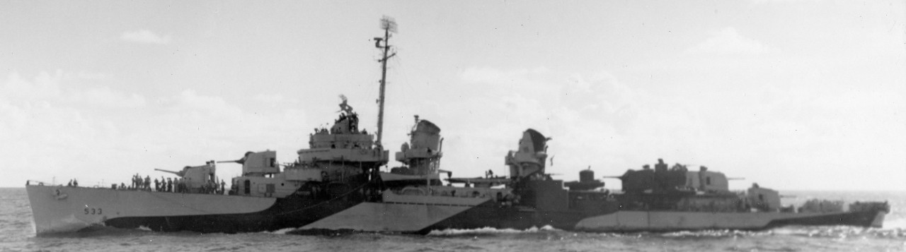 Hoel underway at sea in a camouflage scheme of ocean gray and dull black, 10 August 1944. Note by this point two 40-millimeter twin mounts have replaced the two single-mount 20-millimeters (port and starboard) and the centerline Oerlikon on the platform immediately forward of the bridge. (U.S. Navy Photograph 80-G-248122, National Archives and Records Administration, Still Pictures Division, College Park, Md.)