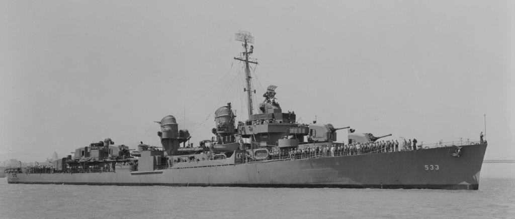 Hoel underway in San Francisco Bay, 3 August 1943, her crew at quarters. At this point the ship's secondary battery includes three 40-millimeter twins and 10 20-millimeter single mounts. (Naval History and Heritage Command Photograph NH 97895)